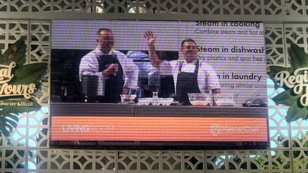 Picture of the big screen with Gary Mehigan