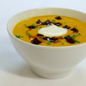 Image of Spicy pumpkin and peanut soup with crispy chorizo